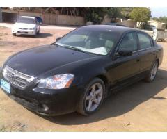 full option nissan altima 2005 black color 6 cylinder accident free in perfect condition only for
